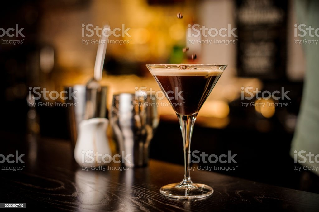 bartender decorated espresso cocktail drink white foam coffee bean stock photo