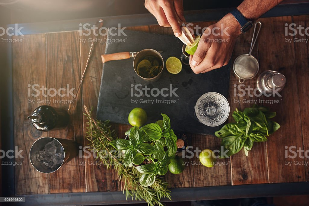 Bartender experimenting with creating new cocktails stock photo