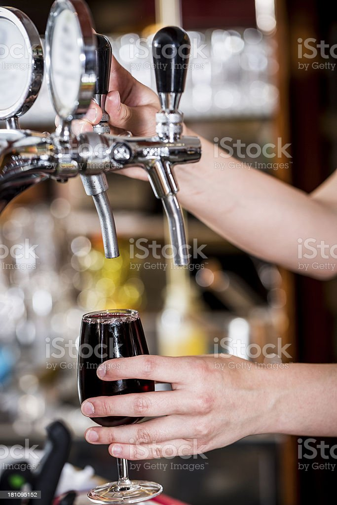 Bartender Filling Red Wine royalty-free stock photo