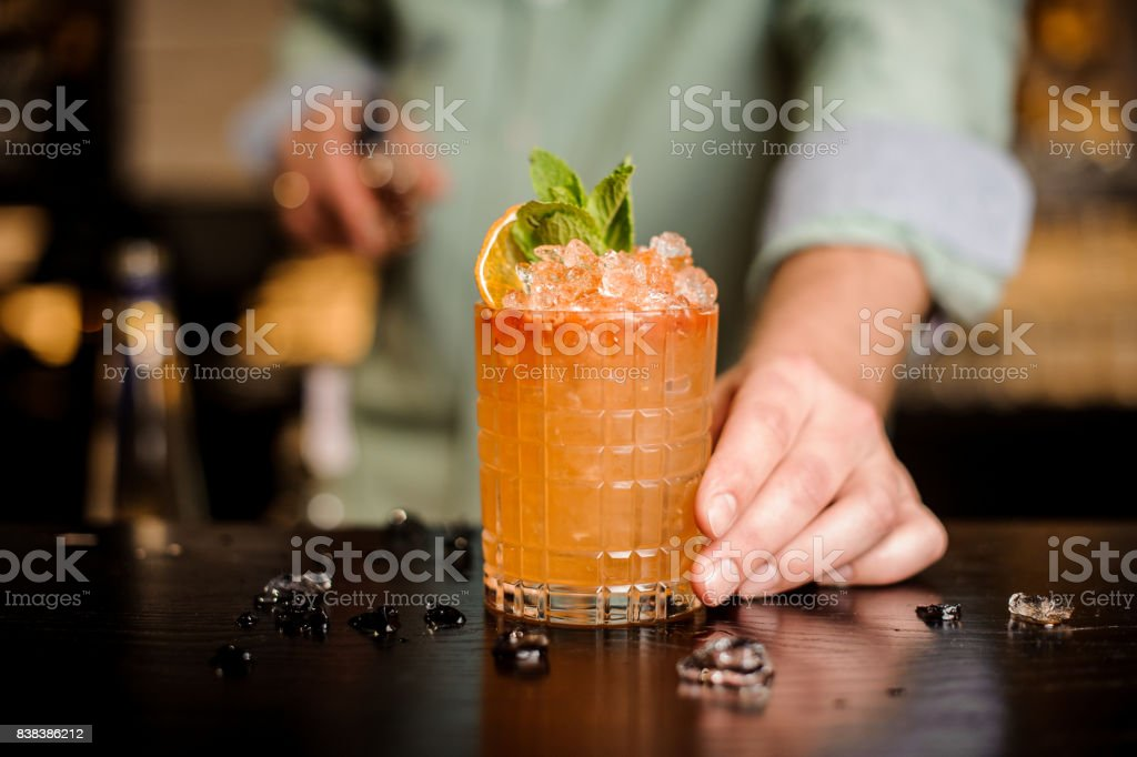Bartender finished decorating his cocktail stock photo