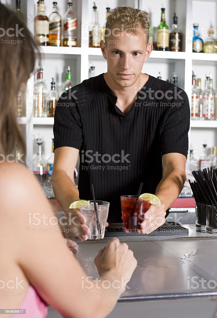Bartender Giving Drinks royalty-free stock photo