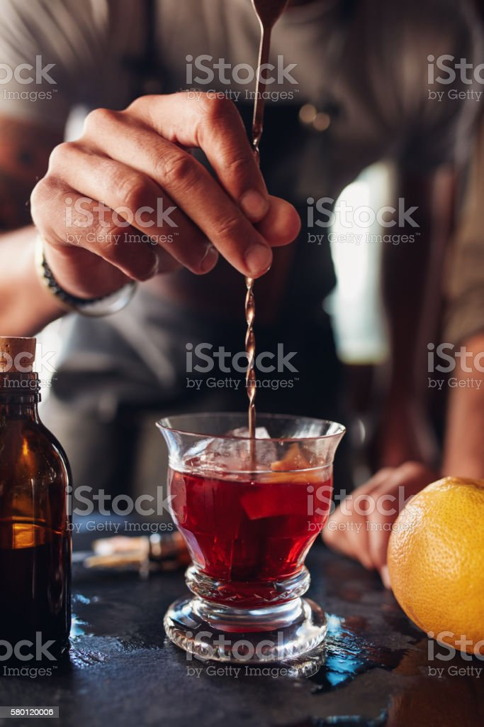 Bartender hand stirring a cocktail stock photo