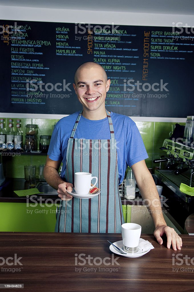Bartender holding coffee cup royalty-free stock photo