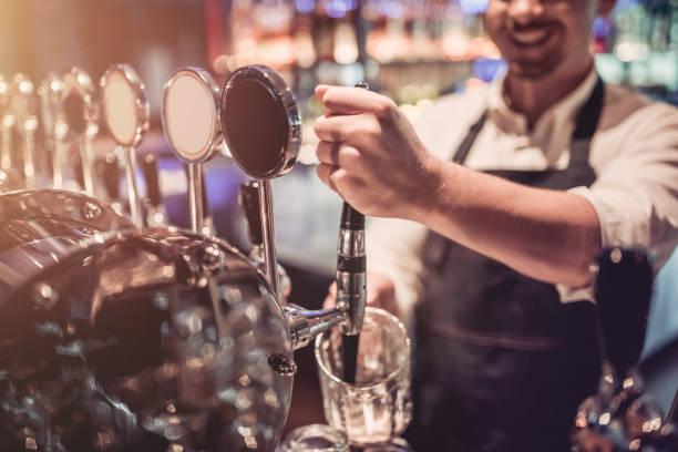 Bartender in pub stock photo