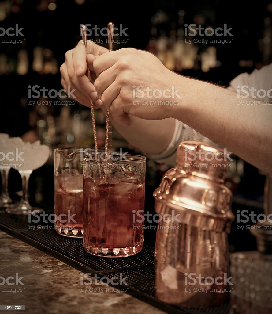 Bartender is stirring cocktails stock photo