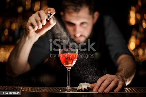 istock Bartender makes an alcohol cocktail with sprayer 1149480449