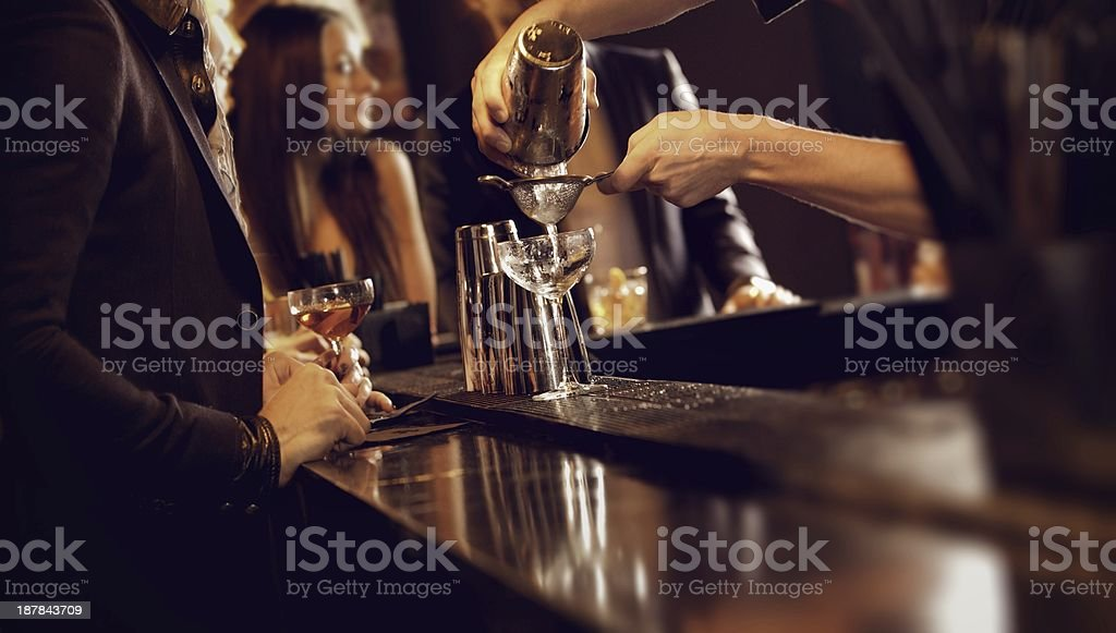 Bartender Making a Cocktail Drink stock photo