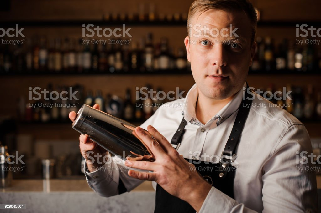 Bartender making a cocktail using a shaker stock photo