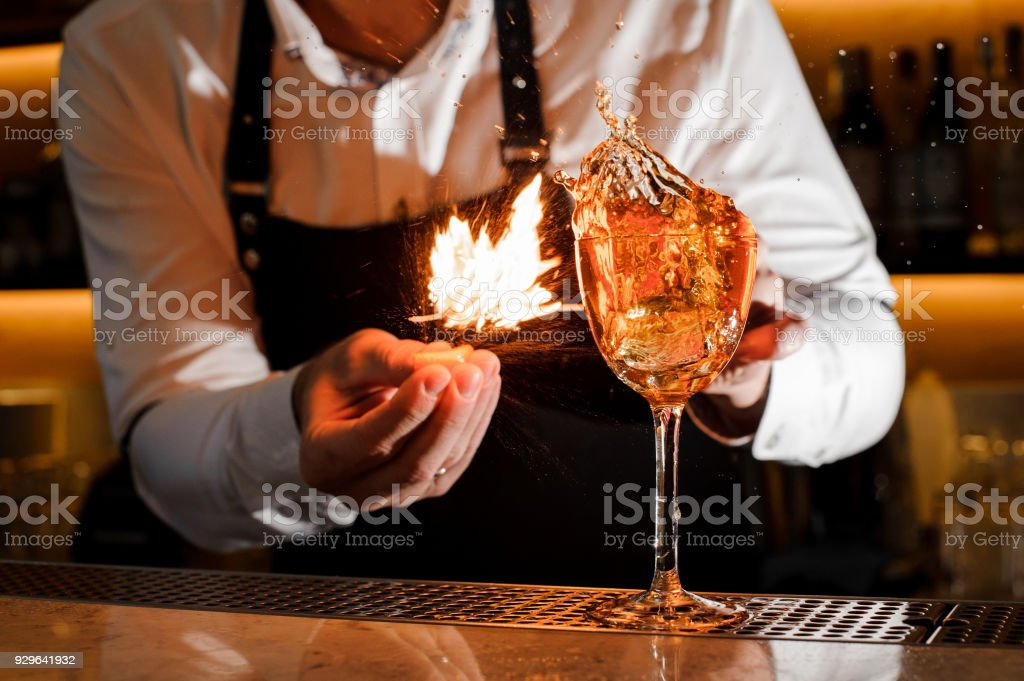 Bartender making a fresh burning cocktail with fire stock photo