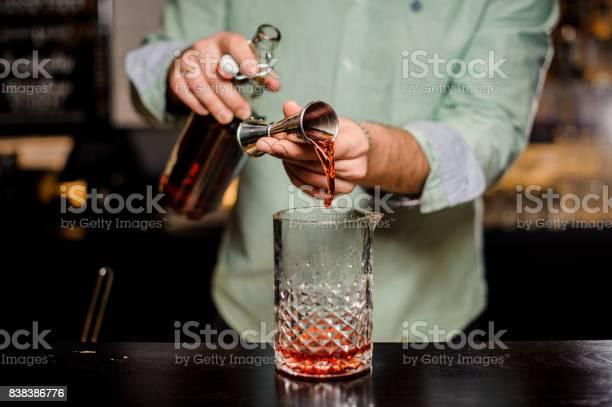 Bartender making alcoholic cocktail metal jigger and bar environment picture id838386776?b=1&k=6&m=838386776&s=612x612&h=grnxpf6awi72ei788xdgfxgwivajfxpipdfcojmdgru=