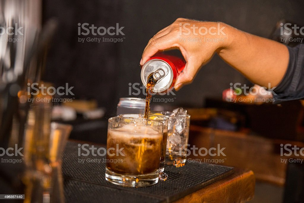 Bartender making cocktail stock photo