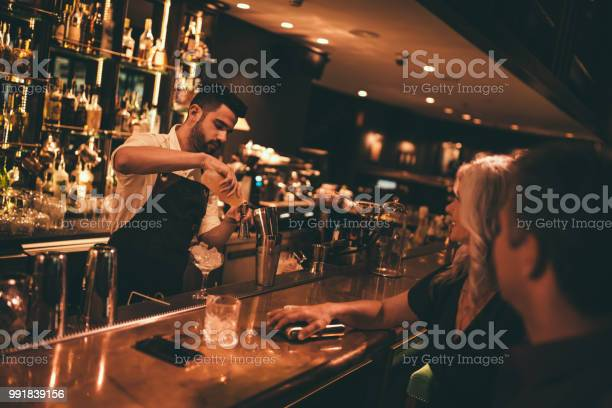 Bartender making cocktails at retro bar for mature couple picture id991839156?b=1&k=6&m=991839156&s=612x612&h=igvghjikizckex6grrk 3ibhnxxi3yambmmnljoicme=
