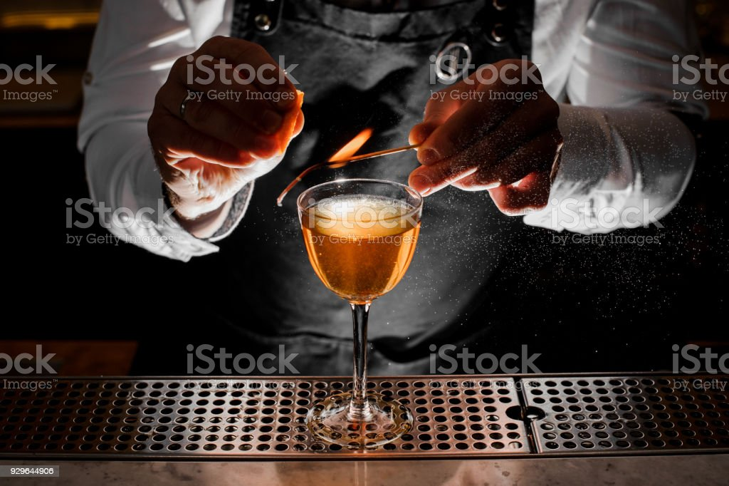 Bartender making fresh alcoholic drink with smoky note stock photo