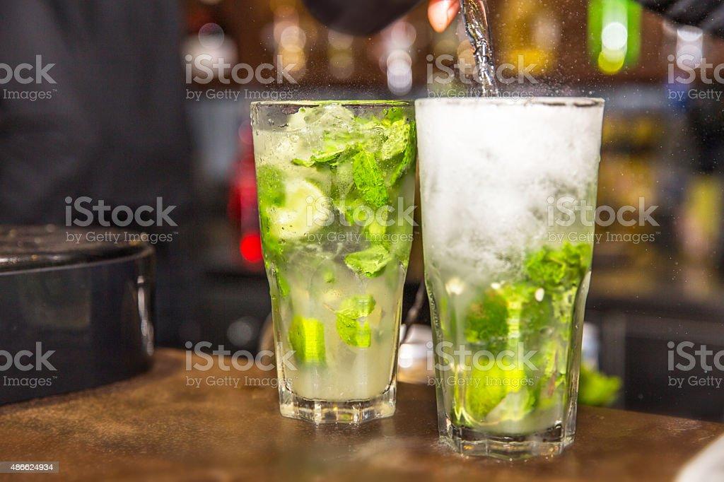 Bartender making mojito stock photo