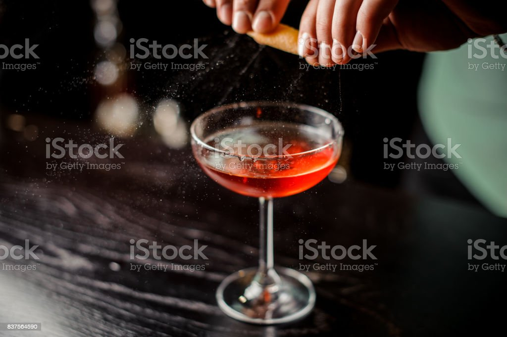 bartender making relaxing cocktail at the bar background no face stock photo