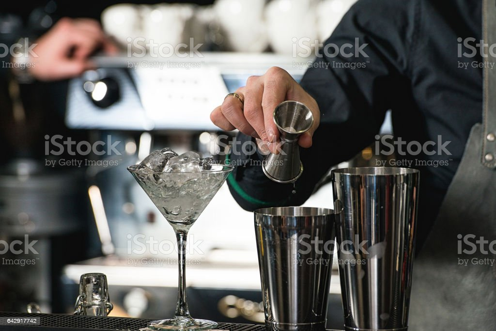 bartender making relaxing coctail on a bar background stock photo