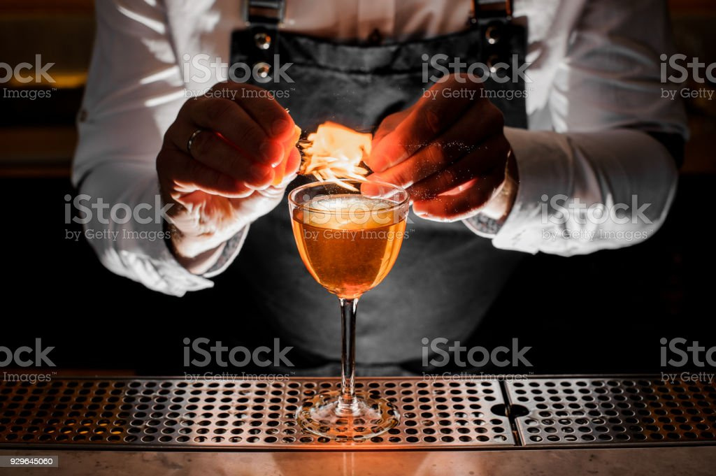 Bartender making the fresh alcoholic drink with a smoky note stock photo