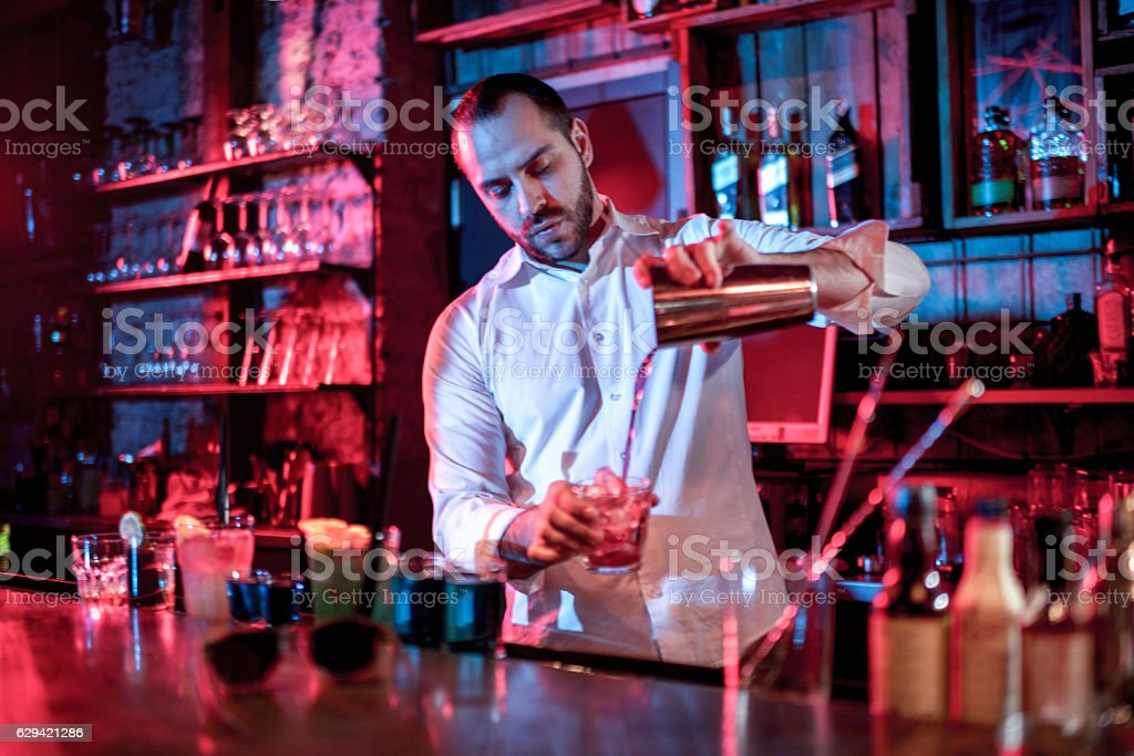 Bartender mixing a cocktail stock photo