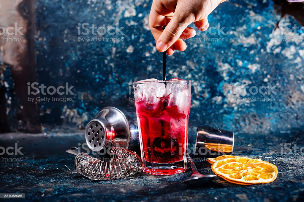 bartender mixing alcoholic cocktail at bar or pub stock photo