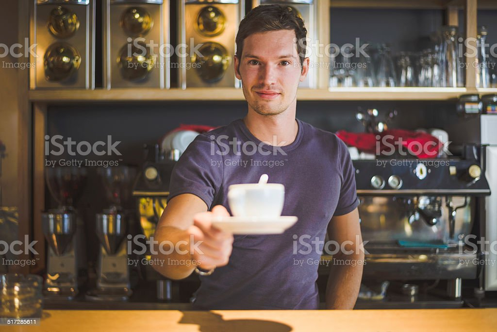 Bartender offering coffee stock photo
