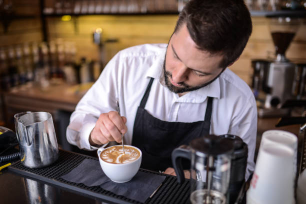 barista - barista making coffee stock pictures, royalty-free photos & images