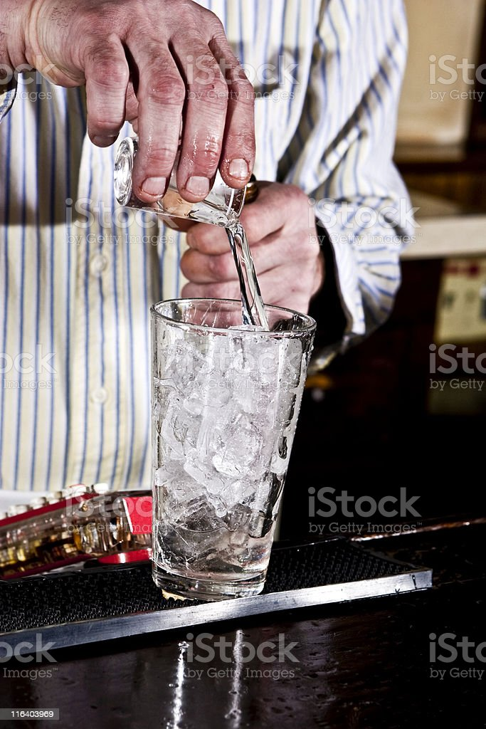 Bartender pouring a drink. royalty-free stock photo