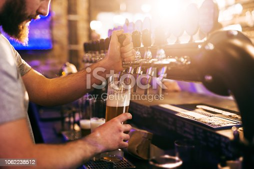 istock Bartender pouring beer. 1062238512