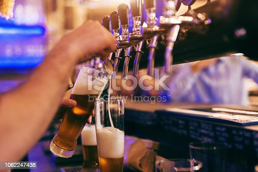 istock Bartender pouring beer. 1062247438