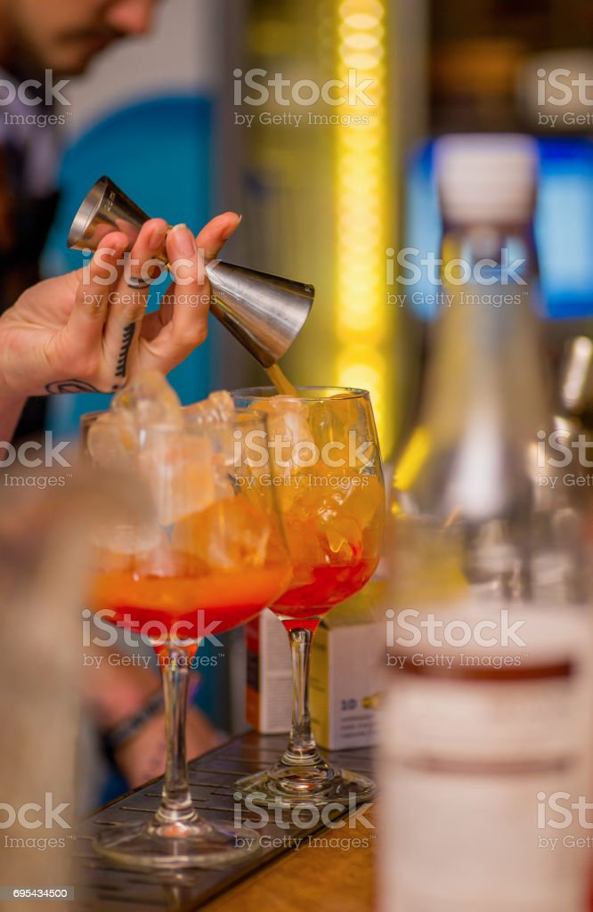 Bartender prepares a cocktail stock photo