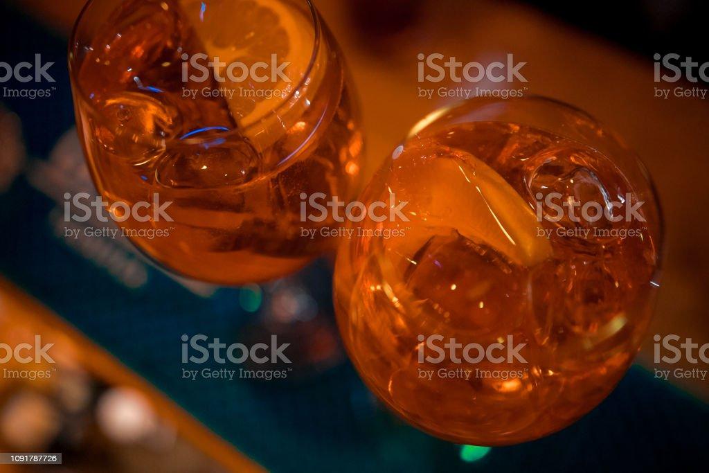 Bartender preparing alcoholic aperitif, aperol spritz cocktail stock photo