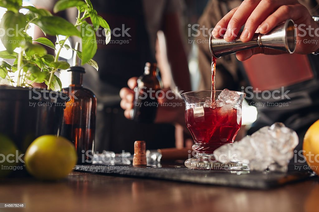 Bartender preparing fresh cocktail stock photo