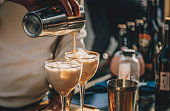 istock Bartender preparing  Irish Cream Liqueur cocktail with shaker 1215389078
