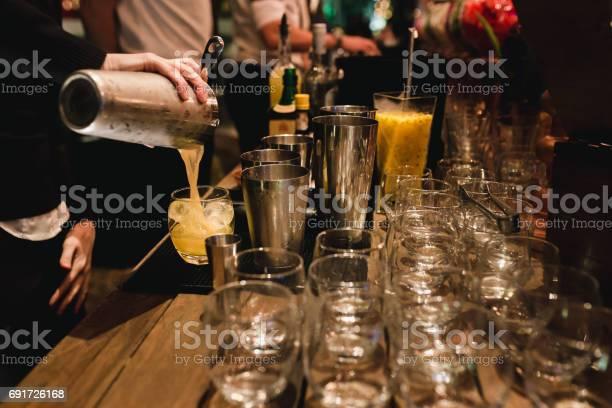 Bartender serving a brazilian caipirinha picture id691726168?b=1&k=6&m=691726168&s=612x612&h=mlcfaspniukm4twtfyj6 bn0sshuxiqd9wo2ar4ojkc=