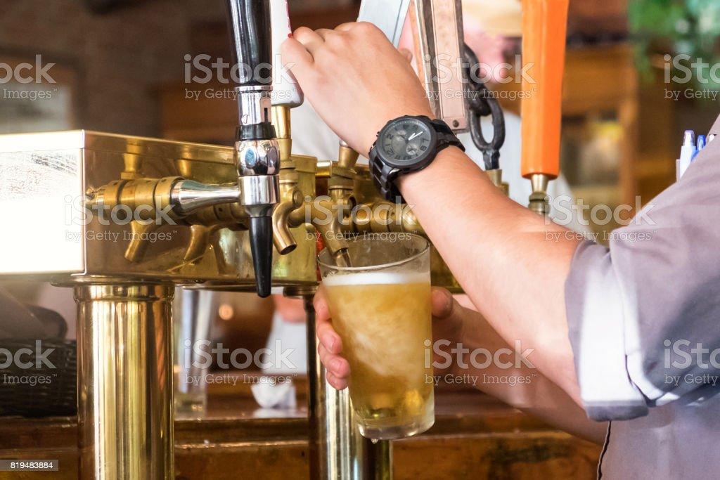 bartender serving beer stock photo