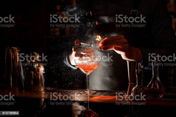 Bartender setting fire to sweet cocktail in bocal picture id915795854?b=1&k=6&m=915795854&s=612x612&h=xjelp7hz 85xywaxu7mu4yax7 coh0lphe dlhrz 8i=