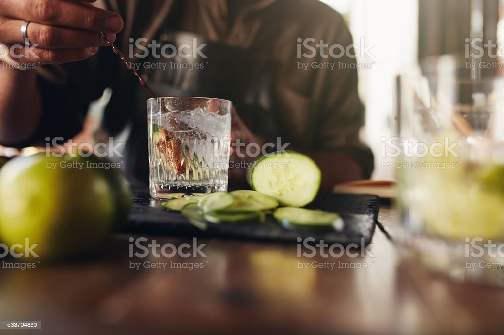Bartender stirring a cocktail stock photo