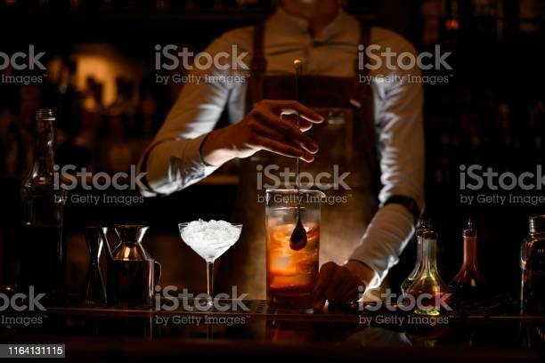 Bartender stirring alcohol cocktail with a spoon picture id1164131115?b=1&k=6&m=1164131115&s=612x612&h=uift cyfqcjh85qdfs6lsvzfuo1d5tsjuvfhditptgw=