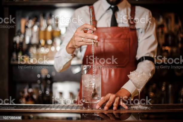Bartender stirring an ice cubes in the cocktail picture id1027093456?b=1&k=6&m=1027093456&s=612x612&h=me67hjozqclmusdzaki5m5ctma0cfpxc85ux 9ip2pk=