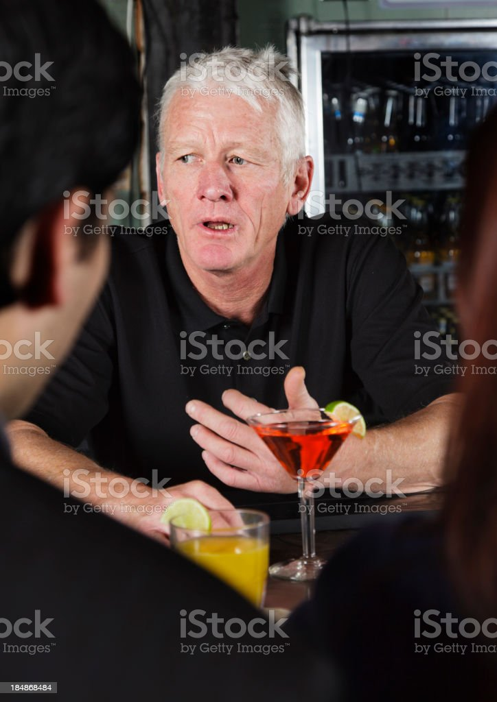 Bartender Telling a Story royalty-free stock photo