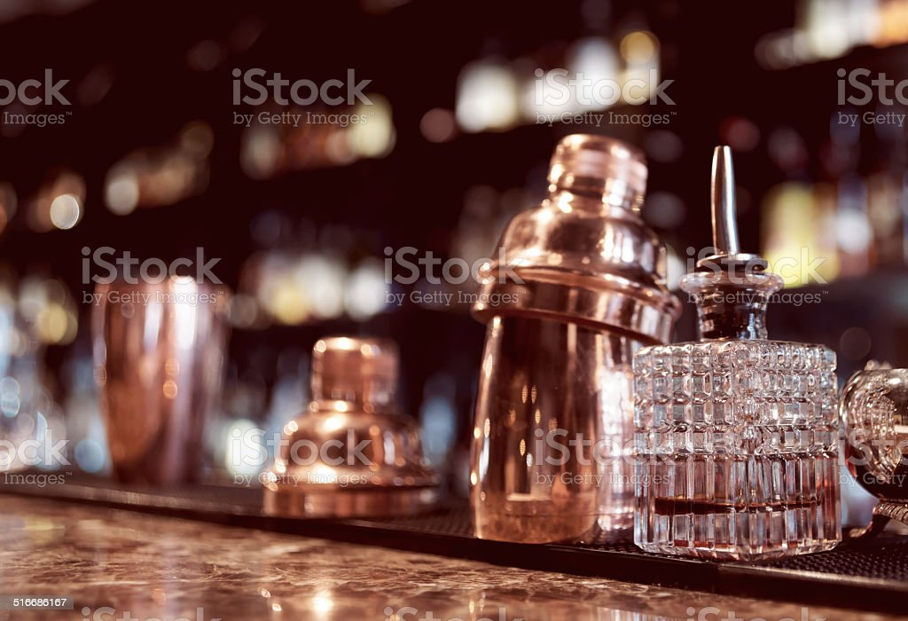 Bartender tools on bar counter, toned stock photo