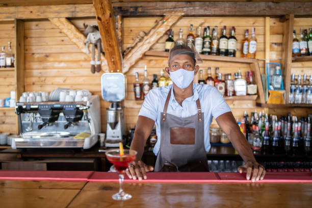 bartender waiting for customers in coronavirus conditions - small business saturday stock pictures, royalty-free photos & images