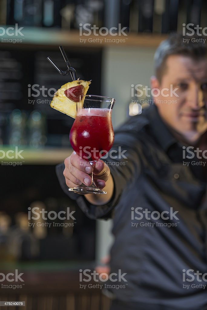 Bartender with a cocktail royalty-free stock photo