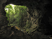 View looking through the cave at Barton Creek.  profile of man near bottom to give perspective; taken in Western Belize