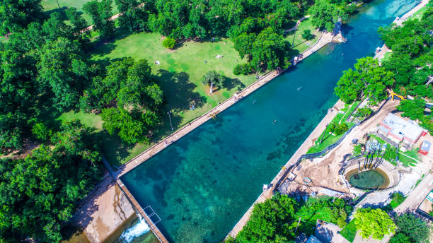 barton springs natural swimming pool is one of the best in the world aerial drone view of summer swimming hole in austin , texas - источник стоковые фото и изображения