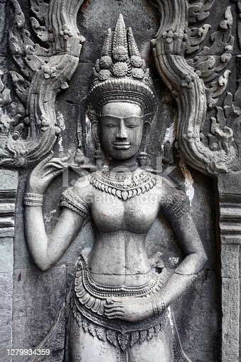 Apsara dancer carved on a wall of Ta Prohm temple at Angkor, Siem Reap province, Cambodia.