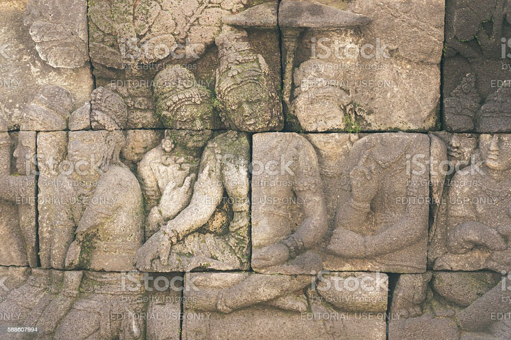 Bas Relief Carvings in Ancient Indonesian Borobudur UNESCO Buddhist Temple stock photo