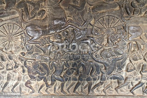 1147569123 istock photo Bas Relief mural of Khmer culture in Angkor Wat temple wall , Cambodia, close up 1178269486