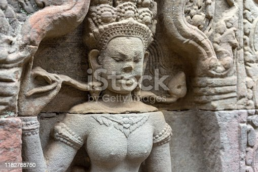 1147569123 istock photo Bas Relief mural of Khmer culture in Angkor Wat temple wall , Cambodia, close up 1182788750
