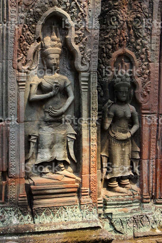 Bas Relief of Apsaras in Cambodian Hindu Temple stock photo