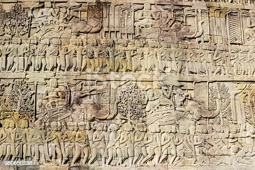 1147569123istockphoto Bas relief of Bayon Temple, Angkor Thom, Siem Reap, Cambodia 950656238